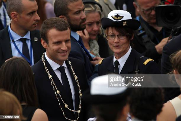 French President Emmanuel Macron greets people after attending the annual Bastille Day military parade on the ChampsElyse on July 14 2017 in Paris...
