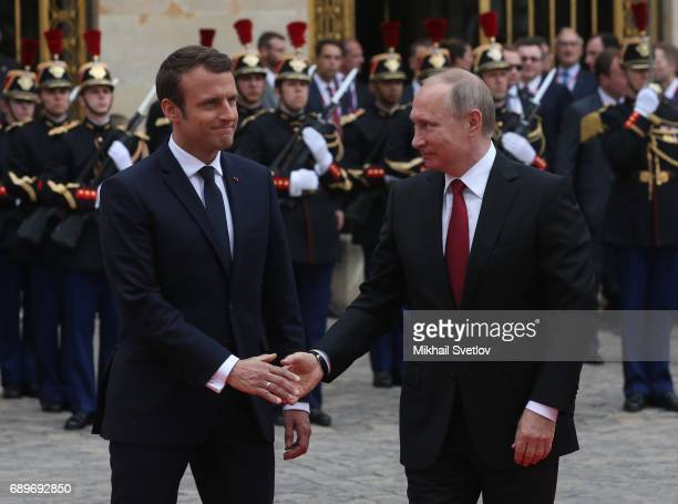 French President Emmanuel Macron greets Russian President Vladimir Putin duirng their meeting in Versailles France May2017 Vladimir Putin is having a...