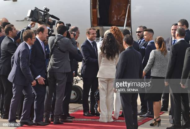 French President Emmanuel Macron greets the Moroccan royal family after landing in Rabat on June 14 2017 Macron is on an official visit to Morocco /...