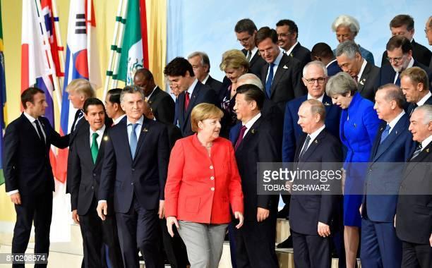 French President Emmanuel Macron greets US President Donald Trump as Indonesia's President Joko Widodo Mexico's President Enrique Pena Nieto German...