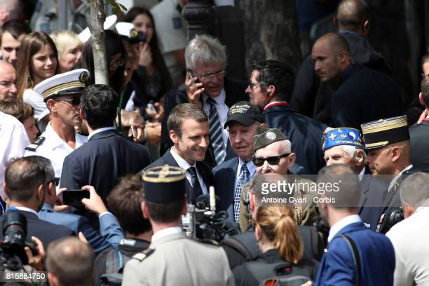 French President Emmanuel Macron greets veterans after attending the annual Bastille Day military parade on the ChampsElyse on July 14 2017 in Paris...