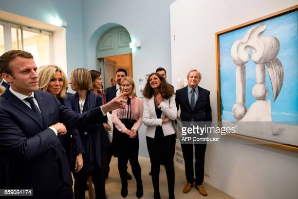 French President Emmanuel Macron his wife Brigitte Macron and French Culture Minister Francoise Nyssen view Pablo Picasso's 1932 painting 'Figures by...