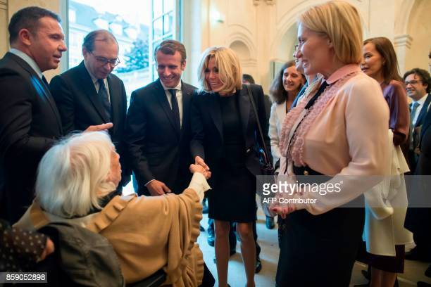 French President Emmanuel Macron his wife Brigitte Macron director of the Picasso museum Laurent Le Bon are greeted by daughter of late Spanish...