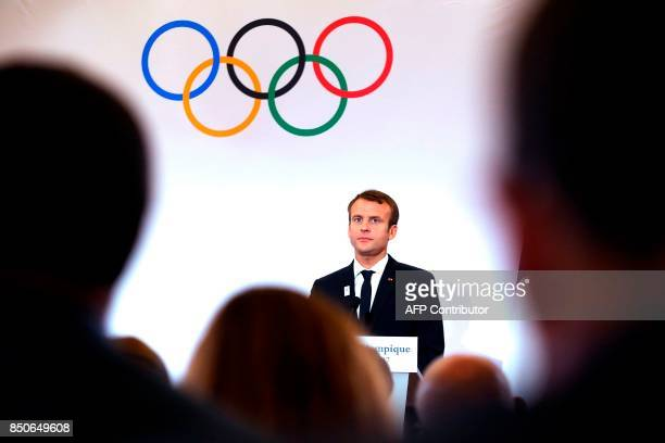 French President Emmanuel Macron holds a press conference during a visit to the site of the future Olympic Sailing venue in Marseille southeastern...