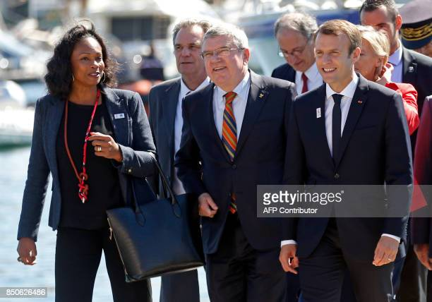 French President Emmanuel Macron International Olympic Committee President Thomas Bach and French Minister for Sports Laura Flessel arrive for a...