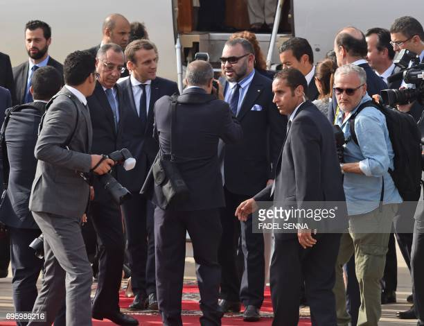 French President Emmanuel Macron is greeted by Moroccan King Mohammed VI upon his arrival in Rabat on June 14 2017 Macron is on an official visit to...
