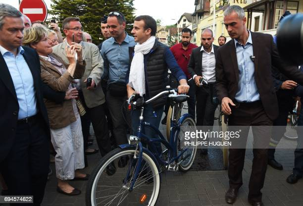 French President Emmanuel Macron is photographed as he takes a bicycle ride on June 10 in Le Touquet northern France the city where he votes on the...