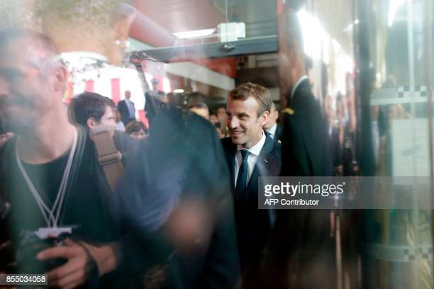French President Emmanuel Macron is pictured through windows during a visit to Gendarmerie barracks in SathonayCamp near Lyon on September 28 2017 as...