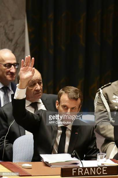 French President Emmanuel Macron is watched by French Foreign Minister JeanYves Le Drian as he participates in an open debate of the United Nations...