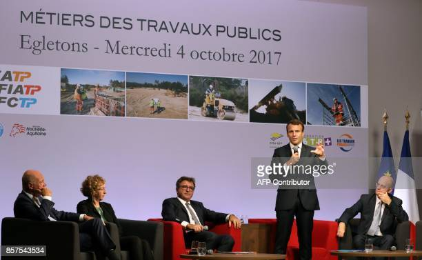 French President Emmanuel Macron is watched by officials including Minister of Employment Muriel Penicaud and Minister of Education JeanMichel...