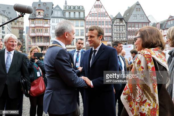 French President Emmanuel Macron is wecomed by the mayor of Frankfurt am Main Peter Feldmann before a welcoming ceremony at the city hall upon his...