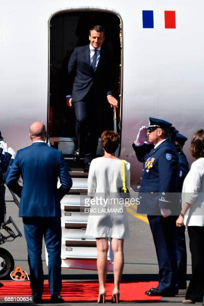 French President Emmanuel Macron is welcomed by Belgian Prime Minister Charles Michel and his partner Amelie Derbaudrenghien as he comes out of the...