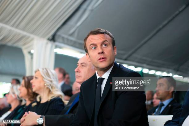French President Emmanuel Macron Israeli Prime Minister Benjamin Netanyahu and his wife Sara Netanhayu attend a ceremony commemorating the 75th...