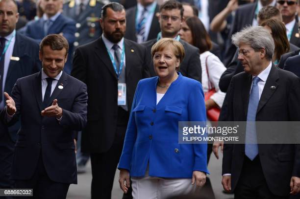 French President Emmanuel Macron Italian Prime Minister Paolo Gentiloni and German Chancellor Angela Merkel arrive at the Hotel San Domenico during...