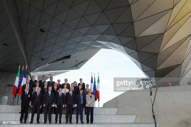 French President Emmanuel Macron Italian Prime Minister Paolo Gentiloni French Interior Minister Gerard Collomb Italian Interior Minister Marco...