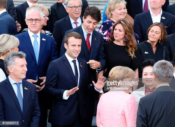 French President Emmanuel Macron jokes with Canada's Prime Minister Justin Trudeau and the wife of Canada's Prime Minister Sophie Gregoire as...