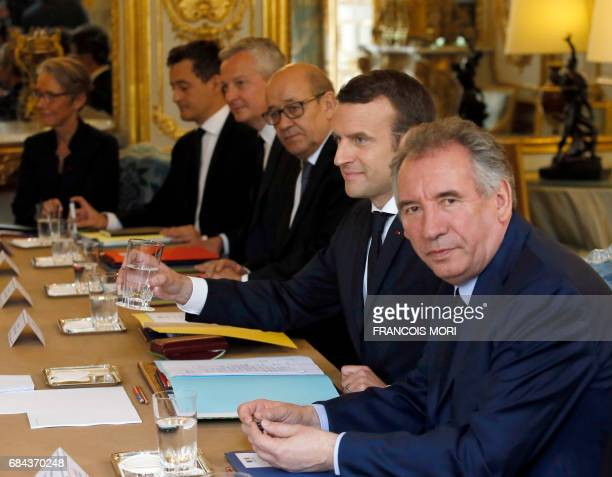 French President Emmanuel Macron Justice minister Francois Bayrou Foreign Affairs minister JeanYves Le Drian Economy minister Bruno Le Maire and...