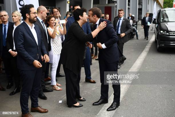 French president Emmanuel Macron kisses French Minister of Higher Education Research and Innovation Frederique Vidal as French Minister of State for...