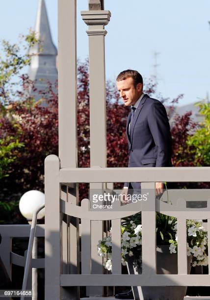 French President Emmanuel Macron leaves his home prior to his vote at the polling station in the town hall in the second round of the French...