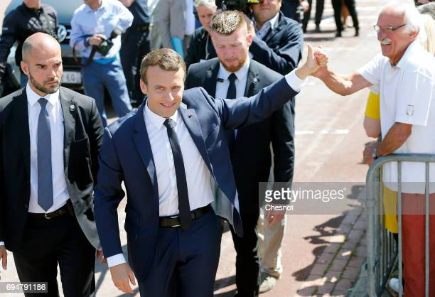 French President Emmanuel Macron leaves the polling station of the town hall after casting his vote in the first round of the French legislative...