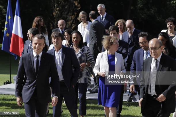 French president Emmanuel Macron leaves with French Minister for the Ecological and Inclusive Transition Nicolas Hulot French Sports Minister Laura...