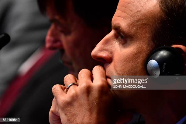 French President Emmanuel Macron listen to speeches during the UN conference on climate change on November 15 2017 in Bonn western Germany / AFP...