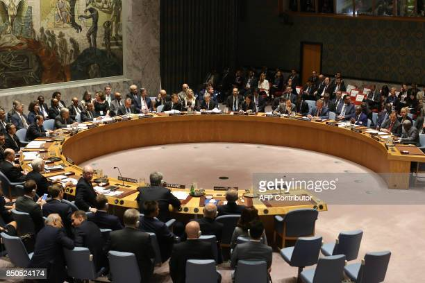 French President Emmanuel Macron listens as he participates with other leaders in an open debate of the United Nations Security Council in New York...