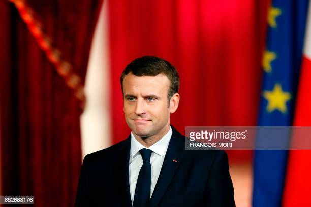 French President Emmanuel Macron listens during his formal inauguration ceremony as French President in the Salle des Fetes of the Elysee...