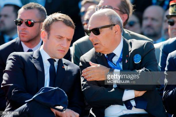 French President Emmanuel Macron listens to Dassault Aviation CEO Eric Trappier during demonstration flights as part of the Paris Air Show in Le...