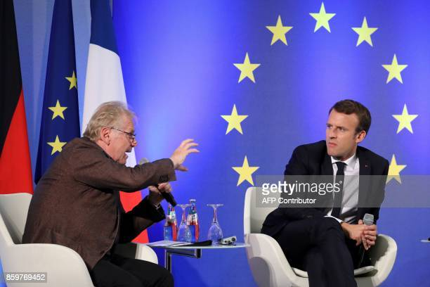 French President Emmanuel Macron listens to European MP Daniel CohnBendit during an open debate on Europe on October 10 2017 at the Goethe University...