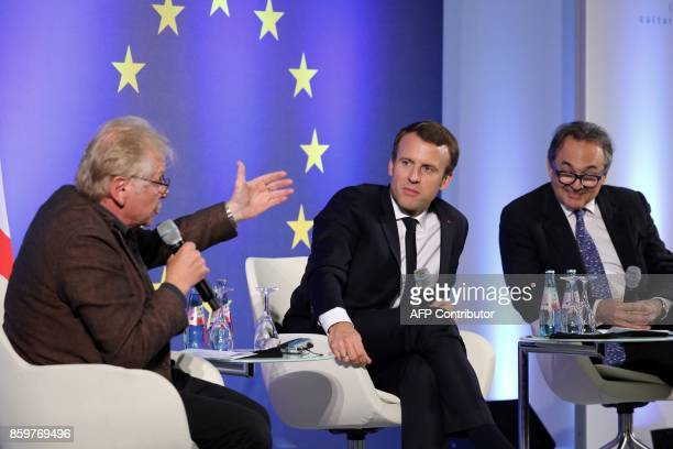 French President Emmanuel Macron listens to European MP Daniel CohnBendit next to Professor at the Paris Institute of Political Studies Gilles Kepel...