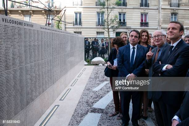 French President Emmanuel Macron listens to Serge Klarsfeld French historian lawyer and Holocaust survivor as he presents to him the 'Jardin du...