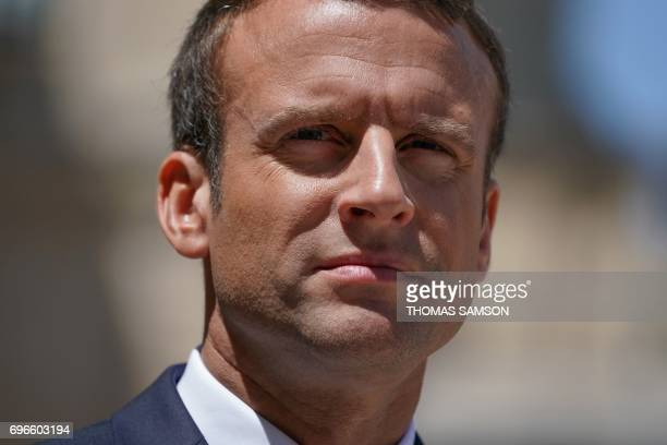 TOPSHOT French President Emmanuel Macron looks on after a meeting with Estonian Prime Minister at the Elysee Palace in Paris on June 16 2017 / AFP...
