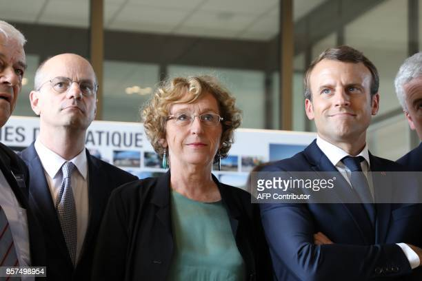 French President Emmanuel Macron looks on as he stands alongside Minister of Employment Muriel Penicaud and Minister of Education JeanMichel Blanquer...