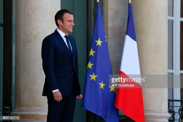 French president Emmanuel Macron looks on before the arrival of US actor and founder of the R20 climate action group Arnold Schwarzenegger on June 23...