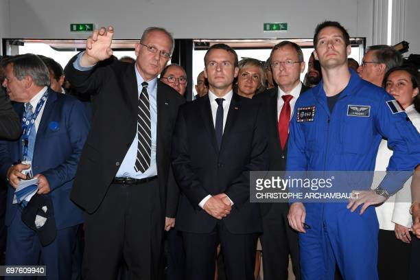 French President Emmanuel Macron looks on with French astronaut Thomas Pesquet and President of the National Space Studies Centre JeanYves Le Gall...
