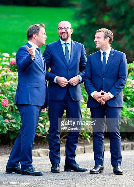 French President Emmanuel Macron Luxembourg's Prime Minister Xavier Bettel and Belgian Prime Minister Charles Michel speak during a meeting at...