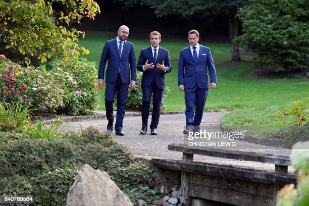 TOPSHOT French President Emmanuel Macron Luxembourg's Prime Minister Xavier Bettel and Belgian Prime Minister Charles Michel speak during a meeting...