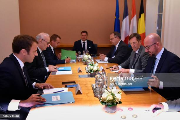 French President Emmanuel Macron Luxembourg's Prime Minister Xavier Bettel and Belgian Prime Minister Charles Michel attend a meeting at Senningen...