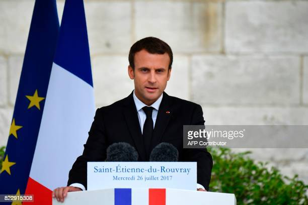 French President Emmanuel Macron makes a speech following a church service marking the first anniversary of the killing the French Catholic priest...