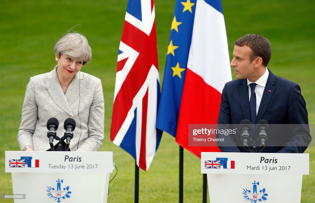 French President Emmanuel Macron makes a statement next to British Prime Minister Theresa May during a joint press conference after a working dinner at the Elysee Presidential Palace on June 13, 2017 in Paris, France. May met Macron to discuss the fight against radicalization and terrorism. They will then go to the stadium of France to pay tribute to the victims of the recent terrorist attacks of London and Manchester before the start of the match of football France-England.
