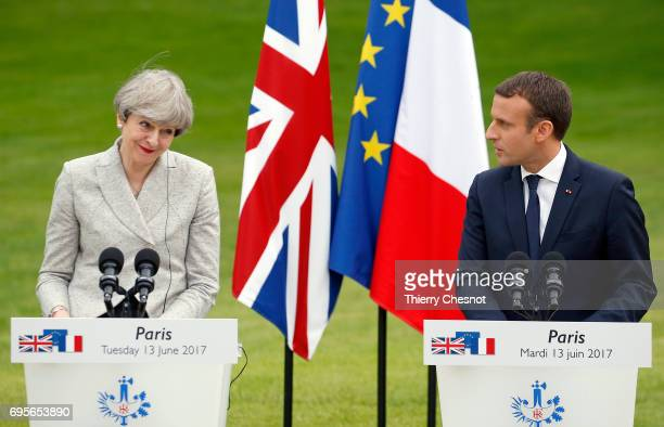 French President Emmanuel Macron makes a statement next to British Prime Minister Theresa May during a joint press conference after a working dinner...