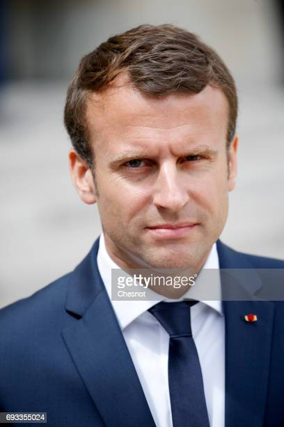 French President Emmanuel Macron makes a statement next to Danish Prime Minister Lars Lokke Rasmussen prior to their meeting at the Elysee...