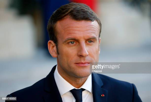 French President Emmanuel Macron makes a statement next to President of the Italian Council Paolo Gentiloni prior to a working dinner at the Elysee...