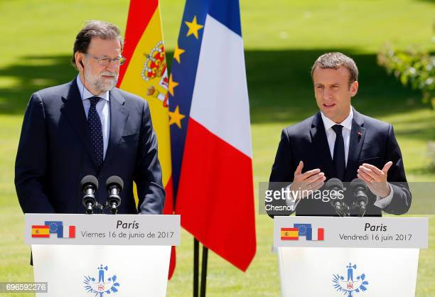 French President Emmanuel Macron makes a statement next to Spanish Prime Minister Mariano Rajoy during a joint press conference after a working lunch...