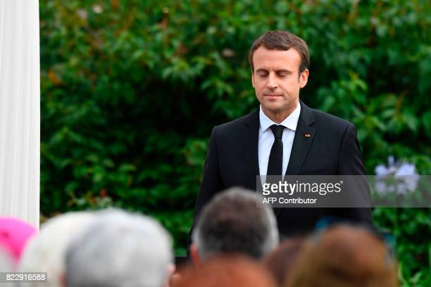 French President Emmanuel Macron makes his way to the podium to give a speech following a church service marking the first anniversary of the killing...