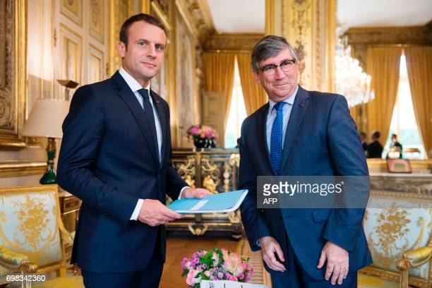 French President Emmanuel Macron meets Gerard Rameix President of the Autorite des Marches Financiers at the Elysee Palace in Paris on June 20 2017 /...