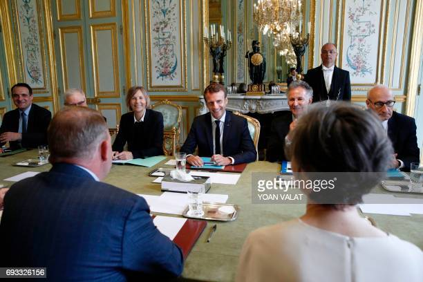 French President Emmanuel Macron meets with Danish Prime Minister Lars Lokke Rasmussen next to French Minister of European Affairs Marielle de Sarnez...
