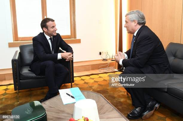 French President Emmanuel Macron meets with European Parliament President Antonio Tajani on the sideline of a European Council in Brussels on June 22...