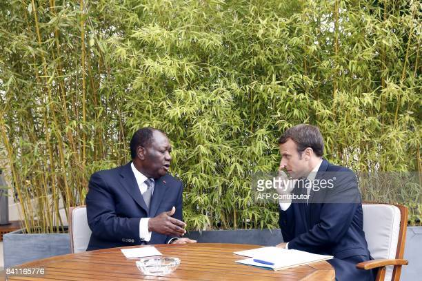 French President Emmanuel Macron meets with his Ivory Coast counterpart Alassane Ouattara at the Elysee presidential palace in Paris on August 31...